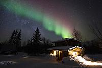 Northern lights and a log cabin in Wiseman, Alaska.