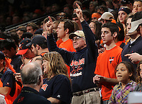 Virginia Cavalier fan Jerry Reid, the oldest student at UVa, cheers during the game against North Carolina in Charlottesville, Va. North Carolina defeated Virginia 54-51.