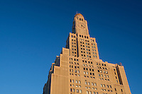 Sun rise on One Hanson Place in Brooklyn, NY, Monday August 1, 2011. Built in 1929 in a modernized Art Deco Byzantine Romanesque style and landmarked in 1977,  One Hanson Place was once the tallest structure in Brooklyn and remains Brooklyn's single most prominent beacon with it's distinctive clock tower with gilded dome.