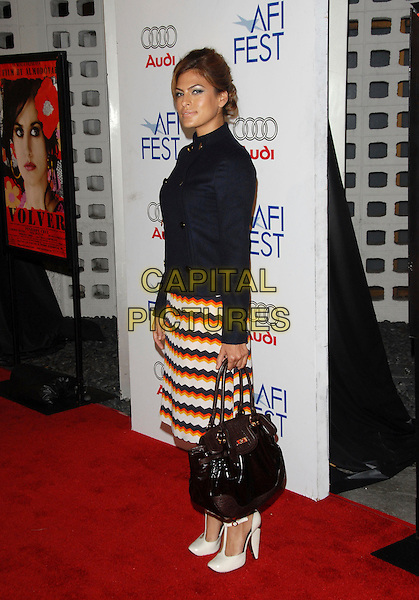 "EVA MENDEZ.The AFI Festival Screening of ""Volver"" held at The Arclight Theatre in Hollywood, California, USA. .November 2nd, 2006.Ref: DVS.full length black Mendes black jacket poloneck high collar skirt white orange striped stripes zigzag pattern shoes bag purse.www.capitalpictures.com.sales@capitalpictures.com.©Debbie VanStory/Capital Pictures"