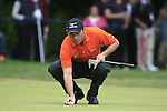 Peter Whiteford (SCO) lines up his putt on the 1st green during the Final Day of the BMW PGA Championship Championship at, Wentworth Club, Surrey, England, 29th May 2011. (Photo Eoin Clarke/Golffile 2011)