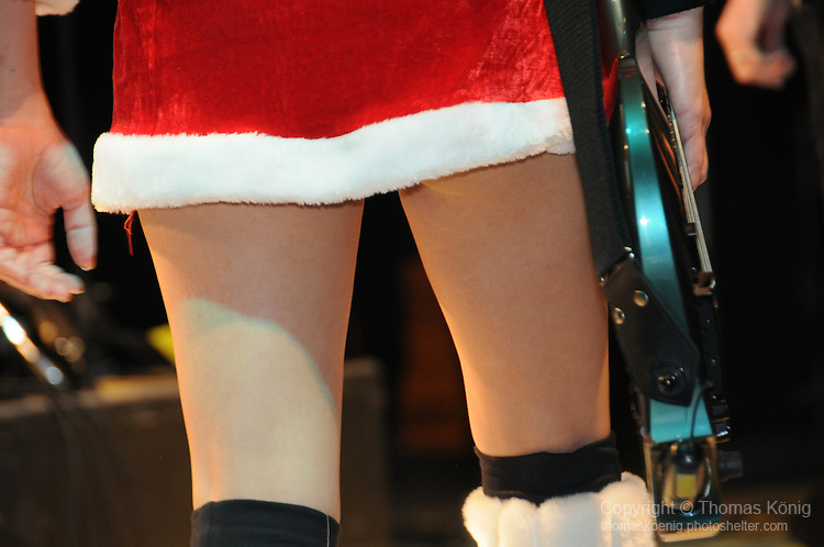 Chthonic Concert, Kaohsiung -- A different view of Chthonic bassist Doris Yeh in a Santa Claus costume.