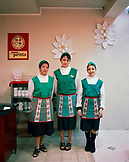 ARGENTINA, Bariloche, portrait of young workers at the Turista Chocolate store.