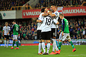 Germany's Joshua Kimmich celebrates with fellow team mates after scoring the third goal aginst N.Ireland during the FIFA World Cup 2018 Qualifying Group C qualifying soccer match between Northern Ireland and Germany at the National Football Stadium at Windsor Park, Belfast, Northern Ireland, 5 Oct 2017. Photo/Paul McErlane