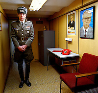 Marco is a former soldier of the East German National People's Army, NVA. He is now a tour guide in this former Stasi nuclear bunker. Hanging on the wall is a portrait of Erich Honecker. The Cold War, which formed part of the collective consciousness of post war Europe from 1945 until 1989, dominated the military and political landscape. These sparse and ageing relics of the covert war in Europe remain as testaments to the existence of this significant period in the shared history of the East and West. CHECK with MRM/FNA