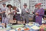"Derby Day Epsom Downs. The English Season published by Pavilon Books 1987. Picnic in car park Typical 1980s fashion mens suits have been hired from Moss Bross, women wear ""power shoulders"""