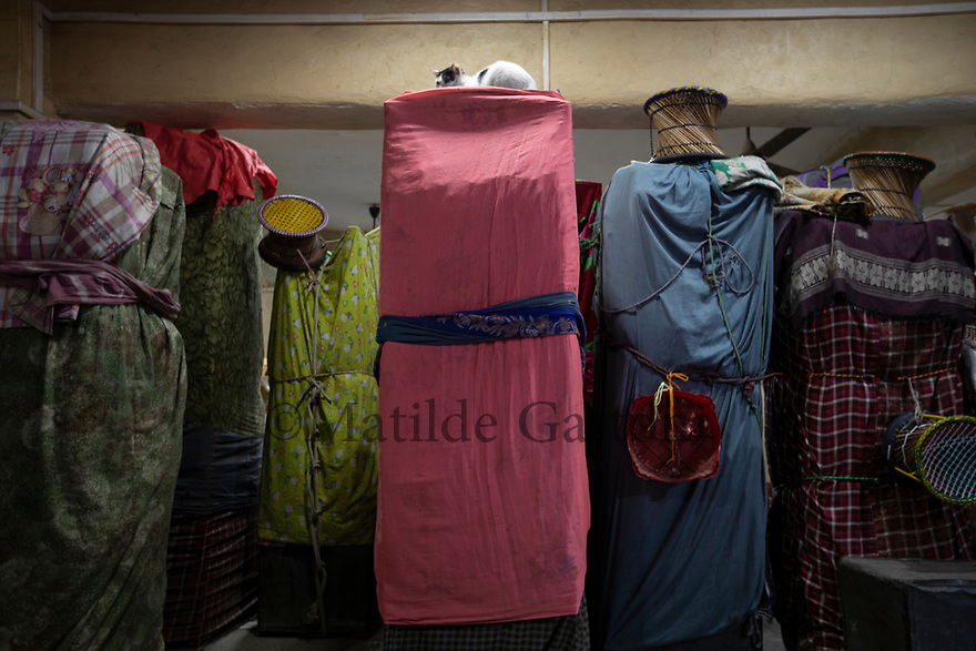 India - Manipur - Imphal - Apart from fresh food, goods are kept inside the market at night, locked in metal boxes, covered with textiles. Young boys are paid to sleep in the stalls and watch out for potential thieves.