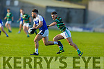 St Brendans James Duggan keeps a watchful eye on Cormac linnane of Shannon Rangers in the County Football Championship 3rd round game on Saturday.