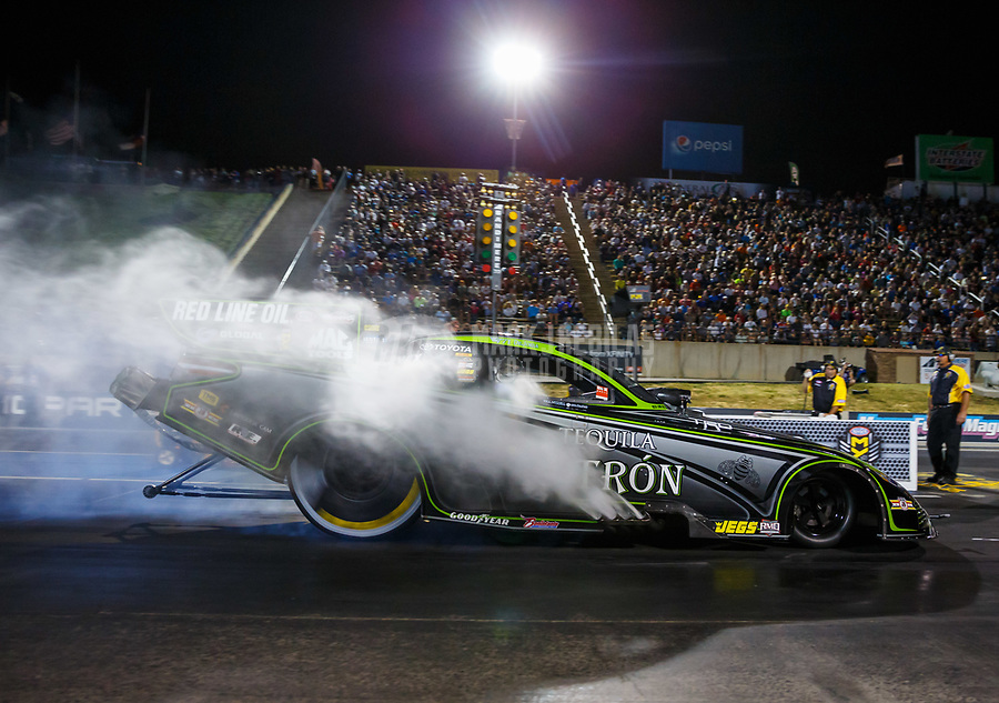 Jul 21, 2017; Morrison, CO, USA; NHRA funny car driver Alexis DeJoria during qualifying for the Mile High Nationals at Bandimere Speedway. Mandatory Credit: Mark J. Rebilas-USA TODAY Sports