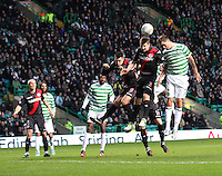 Paul Dummett and Mikael Lustig challenge in the air in the Celtic v St Mirren Clydesdale Bank Scottish Premier League match played at Celtic Park, Glasgow on 15.12.12.