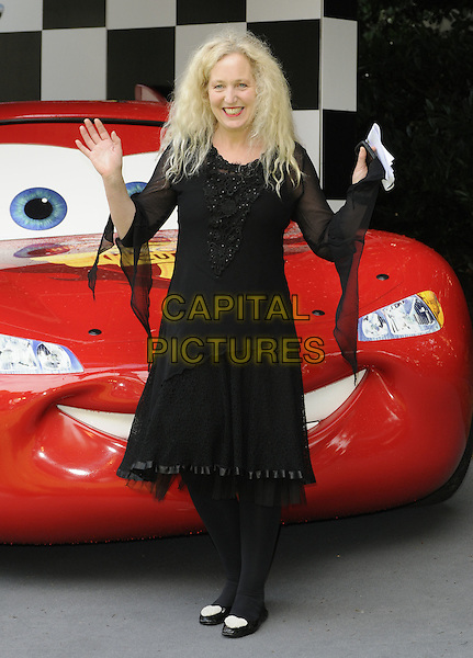 DEBBIE BRIGHT.UK Premiere of 'Cars 2' at Whitehall Gardens, London, England..July 17th 2011.full length black dress sheer sleeves hands arms tights.CAP/CAN.©Can Nguyen/Capital Pictures.