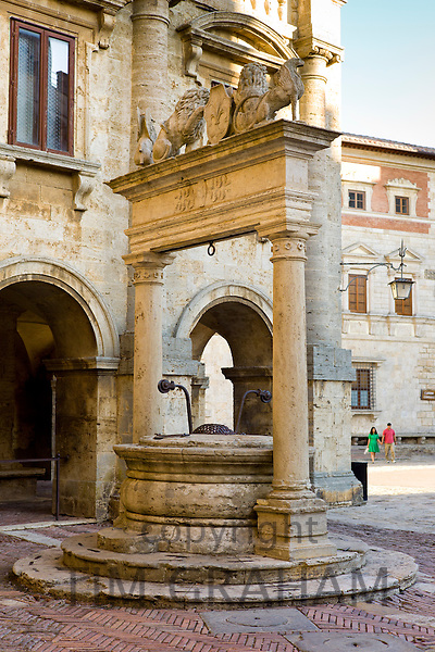 Well of griffins and lions, 16th Century, by Palazzo del Capitano del Popolo, in Piazza Grande in Montepulciano, Tuscany, Italy