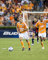 Houston Dynamo forward Brian Mullan (9) dribbles the ball downfield.  Houston Dynamo defeated Atlante FC 4-0  during the group stage of the Superliga 2008 tournament at Robertson Stadium in Houston, TX on July 12, 2008.