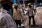 Indian workers seen working at the construction site of the Adani Power plant of 4620 MW capacity in Mundra port industrial city of Gujarat, India. Indian power companies have handed out dozens of major contracts to Chinese firms since 2008. Adani Power Ltd have built elaborate Chinatowns to accommodate Chinese workers, complete with Chinese chefs, ping pong tables and Chinese television. Chinese companies now supply equipment for about 25% of the 80,000 megawatts in new capacity.