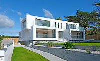 BNPS.co.uk (01202 558833)<br /> Pic: LillicrapChilcott/BNPS<br /> <br /> Crisp modern lines...<br /> <br /> A brand new futuristic property perched right on the edge of a sea wall overlooking some of the finest sailing waters in the country has gone up for sale for £4.5m.<br /> <br /> The ultra-modern home and just been built on remote headland in the Cornish sailing village of St Just.<br /> <br /> It replaced a large bungalow that stood on the coastal plot for over 80 years and was demolished by owner and architect Callum Wason.