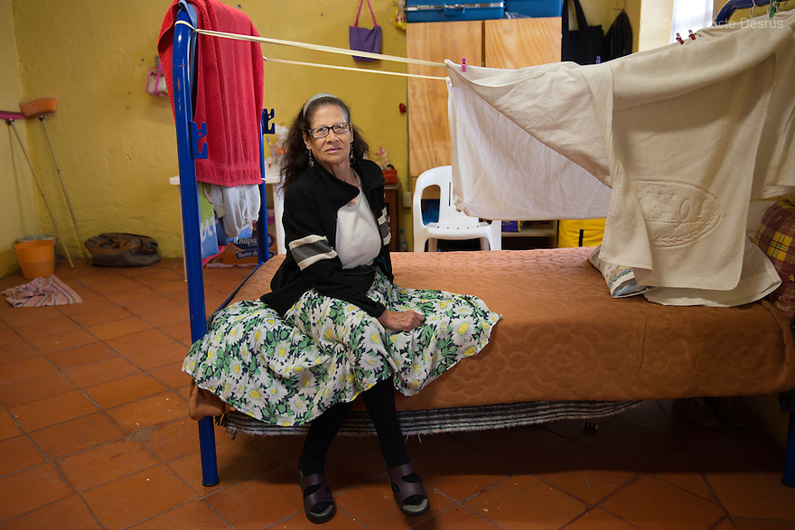 Patricia, a resident of Casa Xochiquetzal, portrayed in her bedroom at the shelter in Mexico City, Mexico on February 10, 2017. Casa Xochiquetzal is a shelter for elderly sex workers in Mexico City. It gives the women refuge, food, health services, a space to learn about their human rights and courses to help them rediscover their self-confidence and deal with traumatic aspects of their lives. Casa Xochiquetzal provides a space to age with dignity for a group of vulnerable women who are often invisible to society at large. It is the only such shelter existing in Latin America. Photo by Bénédicte Desrus