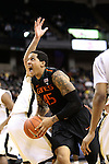 Miami (Fl) Hurricanes forward/center Julian Gamble (45) muscles his way to the basket against Wake. Miami wins a close one in the final seconds 74-73.