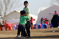 Pictured: Two young boys play at the refugee camp Tuesday 23 February 2016<br /> Re: Migrants trying to cross the Greek-FYRO Macedonian border, were turned away by the authorities in Idomeni, Greece.