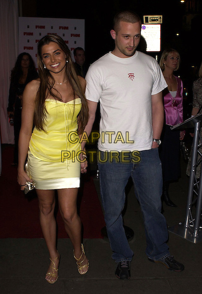 LOUISE GLOVER & GUEST.The FHM 100 Sexiest Women In The World Party 2006 at Madame Tussauds, London, UK. .May 3rd, 2006.Ref: CAN.full length yellow dress jeans denim couple.www.capitalpictures.com.sales@capitalpictures.com.©Capital Pictures