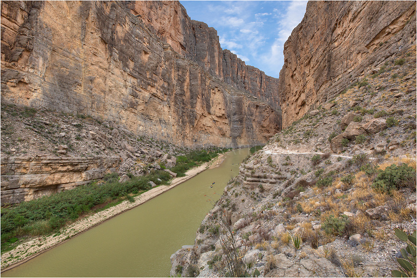 From a perch above Saint Elena Canyon, this Big Bend National Park image features the rugged cliffs and valley carved by the Rio Grande River and the tiny canoers below in the water. It is a nice hike if you don't mind heights!