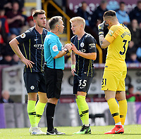Manchester City's Oleksandr Zinchenko remonstrates with Referee Paul Tierney<br /> <br /> Photographer Rich Linley/CameraSport<br /> <br /> The Premier League - Burnley v Manchester City - Sunday 28th April 2019 - Turf Moor - Burnley<br /> <br /> World Copyright © 2019 CameraSport. All rights reserved. 43 Linden Ave. Countesthorpe. Leicester. England. LE8 5PG - Tel: +44 (0) 116 277 4147 - admin@camerasport.com - www.camerasport.com