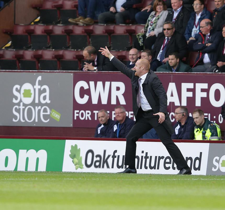 Burnley manager Sean Dyche shouts instructions to his team from the dug-out<br /> <br /> Photographer Stephen White/CameraSport<br /> <br /> Football - The Football League Sky Bet Championship - Burnley v Sheffield Wednesday - Saturday 12th September 2015 -  Turf Moor - Burnley<br /> <br /> &copy; CameraSport - 43 Linden Ave. Countesthorpe. Leicester. England. LE8 5PG - Tel: +44 (0) 116 277 4147 - admin@camerasport.com - www.camerasport.com