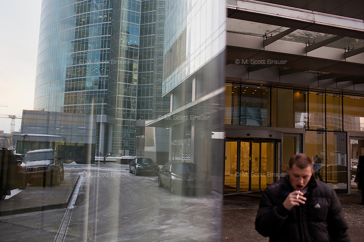 People walk among buildings in Moscow City development area in Moscow, Russia.