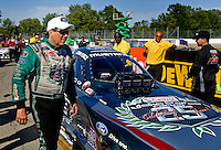 Sept. 6, 2010; Clermont, IN, USA; NHRA funny car driver John Force walks from his car after losing in the finals of the U.S. Nationals at O'Reilly Raceway Park at Indianapolis. Mandatory Credit: Mark J. Rebilas-