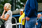 A fan takes full advantage of the outdoor bar area. Yorkshire v Parishes of Jersey, CONIFA Heritage Cup, Ingfield Stadium, Ossett. Yorkshire's first competitive game. The Yorkshire International Football Association was formed in 2017 and accepted by CONIFA in 2018. Their first competative fixture saw them host Parishes of Jersey in the Heritage Cup at Ingfield stadium in Ossett. Yorkshire won 1-0 with a 93 minute goal in front of 521 people.