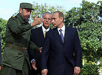 "Fidel Castro, pictured with Russian President, Vladimir Putin, at the ""Palace of the Revolution,"". Putin it is the first president of Russia ex-comunist that Cuba view, after the fall of the ""Wall of Berlin"". December 14, 2000. . Credit: Jorge Rey/MediaPunch"