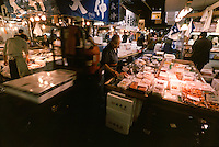 A wide image of general trading activity at  Tsukiji Wholesale fish market n Tokyo, Japan. April 21st 2006