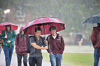 MSU students attempt to stay dry as they make their way to classes during a Wednesday [Nov. 7] morning rain shower. More rain is in the forecast for Thursday and Friday, but sunshine is expected on campus over the weekend.<br />  (photo by Megan Bean / &copy; Mississippi State University)