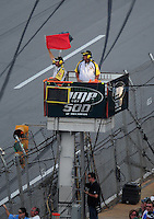 Oct 5, 2008; Talladega, AL, USA; NASCAR Sprint Cup Series officials wave the red flag after a multi-car crash during the Amp Energy 500 at the Talladega Superspeedway. Mandatory Credit: Mark J. Rebilas-