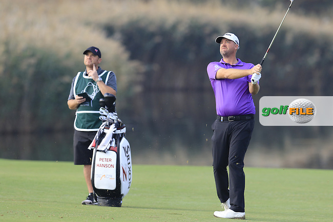 Peter Hanson (SWE) plays his 2nd shot on the 14th hole during Thursday's Round 1 of the 2016 Portugal Masters held at the Oceanico Victoria Golf Course, Vilamoura, Algarve, Portugal. 19th October 2016.<br /> Picture: Eoin Clarke | Golffile<br /> <br /> <br /> All photos usage must carry mandatory copyright credit (&copy; Golffile | Eoin Clarke)