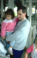 Father age 32 holding 3 year old daughter at Minnesota State Fair.  St Paul Minnesota USA