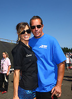 Aug. 3, 2014; Kent, WA, USA; NHRA funny car driver Jeff Diehl and wife Leeza Diehl during the Northwest Nationals at Pacific Raceways. Mandatory Credit: Mark J. Rebilas-