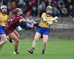 Olivia Phelan of Clare in action against Leanne Helebert of Galway during their Minor A All-Ireland final at Nenagh.  Photograph by John Kelly.