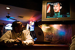 November 4, 2008. Greensboro, NC.. Local college students and other supporters of president elect Barack Obama gathered at Ham's, a bar in Greensboro, to watch the acceptance speech of of the first African American elected president of the United States.. Brandon Lowe, a recent graduate of UNC-Greensboro, watches the acceptance speech of president elect Barack Obama.