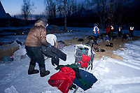 Dan Kaduce suits up to leave after his 24 hour layover at daybreak at -15 degrees in Takotna during the 2010 Iditarod