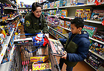 Carson City Sheriff's Deputy Liz Lopez shops with Alberto, 10, at the 15th annual Holiday with a Hero program at Walmart in Carson City, on Wednesday, Dec. 19, 2018. The program, which pairs local heroes with more than 200 K-8th graders, provides a $100 Christmas shopping spree at Walmart.  <br /> Photo by Cathleen Allison/Nevada Momentum