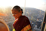 "An Indian woman is seen on the newly opened glass balconies ""The Ledge"" at the Skydeck at the Sears Tower in Chicago, Illinois on July 6, 2009."