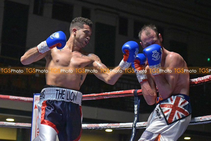 Ramon Perez (white/red/black shorts) defeats Paul Cummings during a Boxing Show at York Hall on 6th October 2018