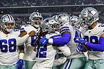 Dallas Cowboys defensive tackle Ricky Walker (68), Dallas Cowboys defensive back Donovan Wilson (37) and Dallas Cowboys cornerback Donovan Olumba (32) in action during the pre-season game between the Tampa Bay Buccaneers and the Dallas Cowboys at the AT & T Stadium in Arlington, Texas.