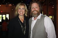 NWA Democrat-Gazette/CARIN SCHOPPMEYER Blake Woolsey, Heels and Hammers master of ceremonies, and Jason Kindall, Habitat for Humanity of Washington County executive director, welcome supporters to the fundraiser for the nonprofit organization's Women Build.