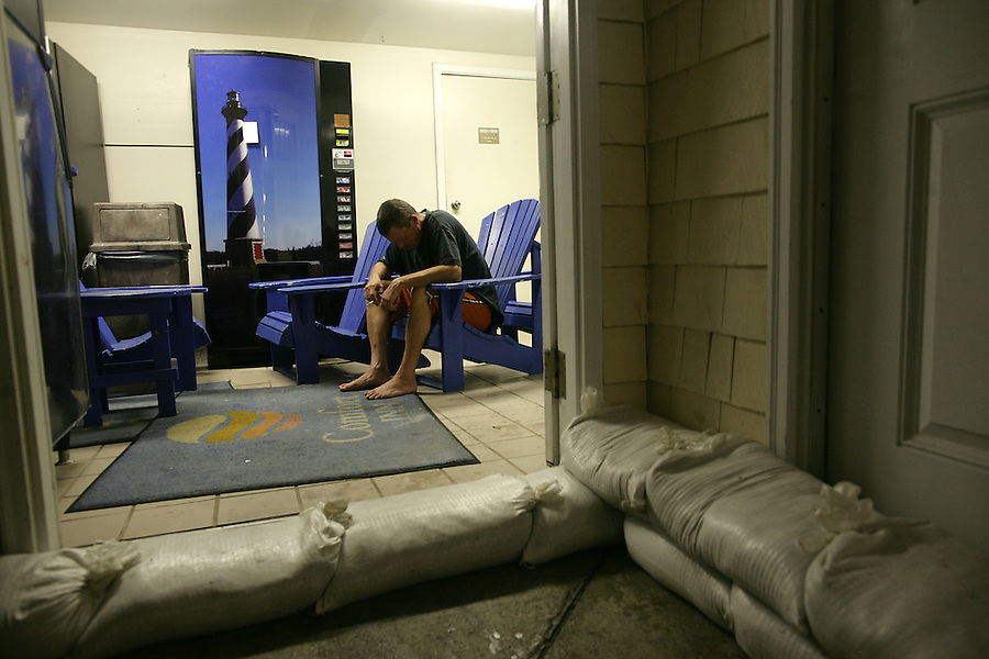 Gerald Carlander, an employee at the Comfort Inn in Buxton, NC, waits out the storm in a break room, sand-bagged in, as Hurricane Irene struck in the early morning on Saturday, Aug. 27, 2011. Photo by Ted Richardson