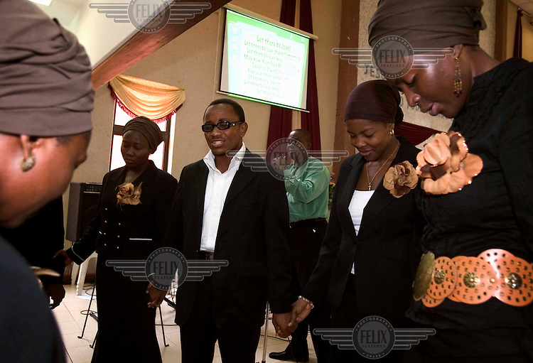 The choir praying after the service at the Redeemed Christian Church of God.