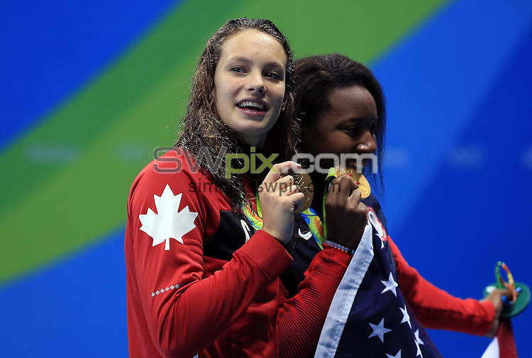 RIO DE JANEIRO, BRAZIL - AUGUST 11:  Penny Oleksiak (L) of Canada and Simone Manuel (R) of the USA win joint Gold in the Women's 100m Freestyle Final on Day 6 of the Rio 2016 Olympic Games at the Olympic Aquatics Stadium on August 11, 2016 in Rio de Janerio, Brazil.  (Photo by Vaughn Ridley/SWpix.com)