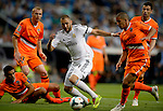 Karim Benzema vies with Feghouli during the Spanish league football match Real Madrid CF vs Valencia CF at the Santiago Bernabeu stadium in Madrid on May 4, 2014. PHOTOCALL3000/