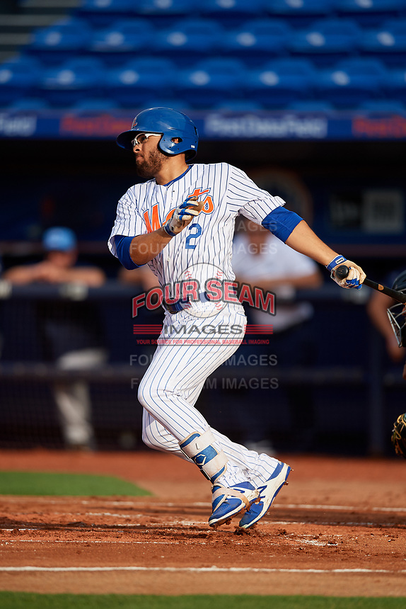 St. Lucie Mets center fielder Desmond Lindsay (2) follows through on a swing during the first game of a doubleheader against the Charlotte Stone Crabs on April 24, 2018 at First Data Field in Port St. Lucie, Florida.  St. Lucie defeated Charlotte 5-3.  (Mike Janes/Four Seam Images)