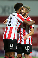 Ollie Watkins and Said Benrahma celebrate Brentford's victory at the final whistle during Brentford vs West Bromwich Albion, Sky Bet EFL Championship Football at Griffin Park on 26th June 2020